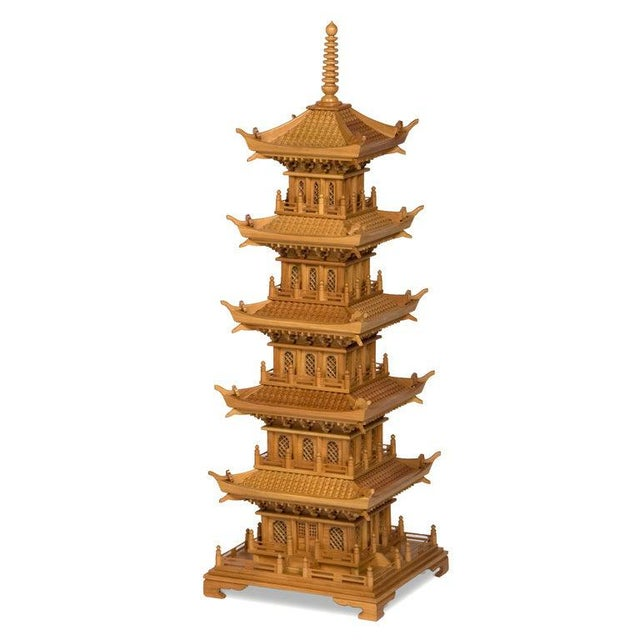 A pair of large pine pagodas, with lattice work windows, operating doors, multi-tiered tiled roofs, carved corbels and...