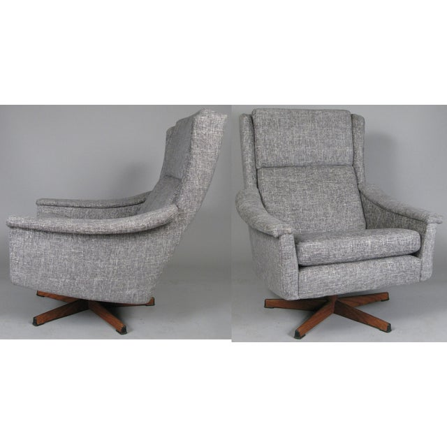 A beautiful pair of vintage 1950s high back lounge chairs, purchased from Illums Bollighus, with swivel bases of steel...