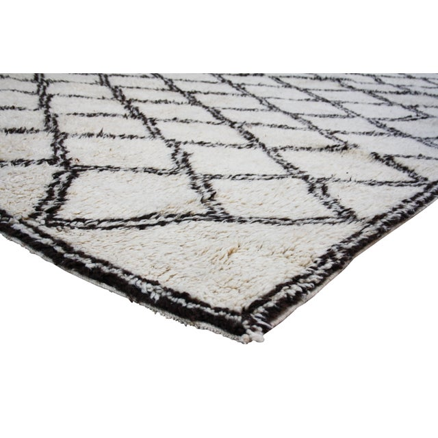 Vintage Beni Ourain rug with diamond motif. Handloomed in the High Atlas Mountains of soft organic wool.