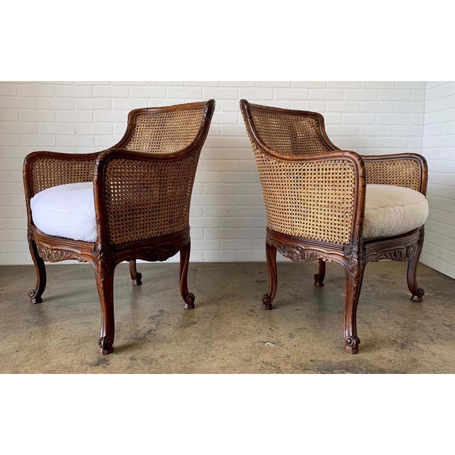 Solid walnut frames with double cane back and sides. The seats are re upholstered in Faux Fur.