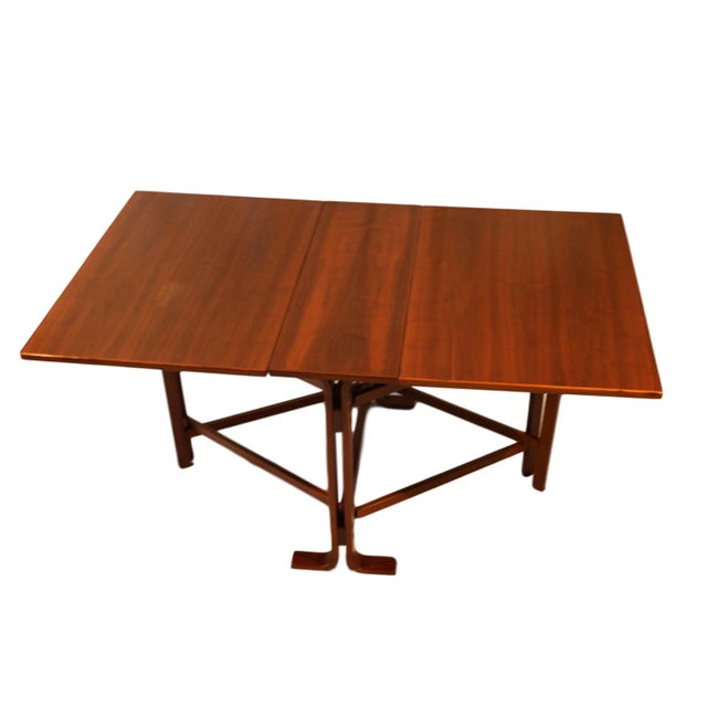 A teak drop leaf gate leg dining table in the manner of Bruno Mathsson. An exceptional work of Danish craftsmanship. This...