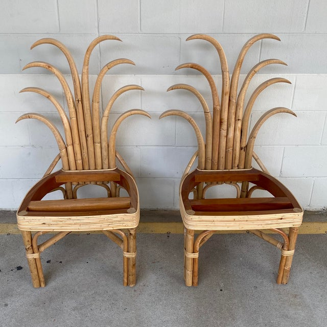Custom made palm frond design natural rattan dining chairs. Sturdy construction and very comfortable. Seat cushion not...