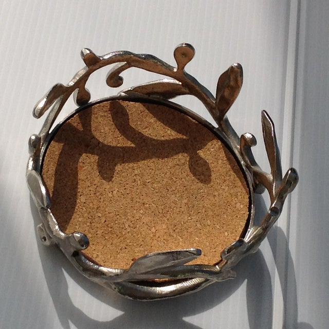 beautiful wine coasters by michael aram a contemporary designer of elegant tabletop accessories.
