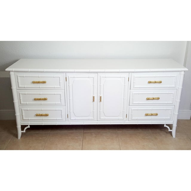 Listing here absolutely gorgeous Dixie Aloha faux bamboo 9 drawer dresser. This would be an elegant piece for any space....