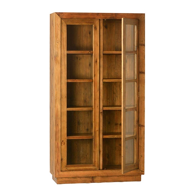 This wood and glass storage cabinet is perfect for dishes or decorative objects. The cabinet features two doors and four...