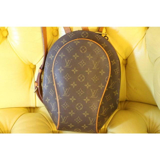 This very nice backpack bag features monogramm canvas, cowhide leather trim and a sturdy pair of cowhide leather...