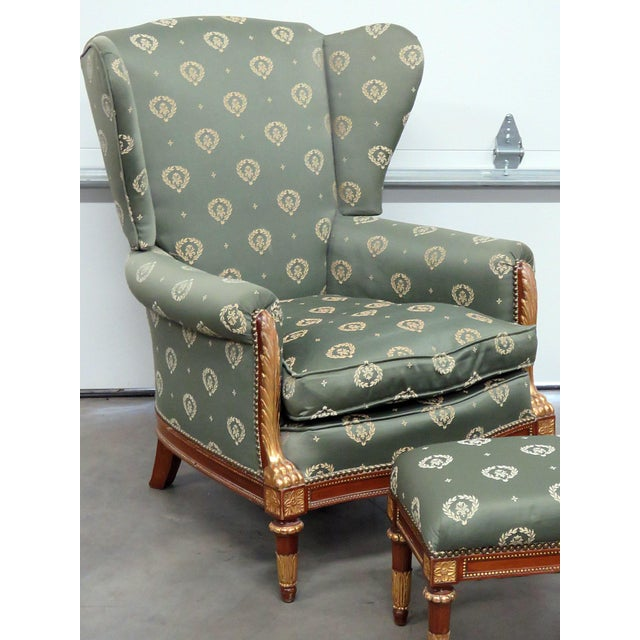 """Jansen Regency style chair and ottoman. Nailhead trim with gilt decor. 18.5"""" seat height. Ottoman measures: 13""""h x 18.25""""w..."""