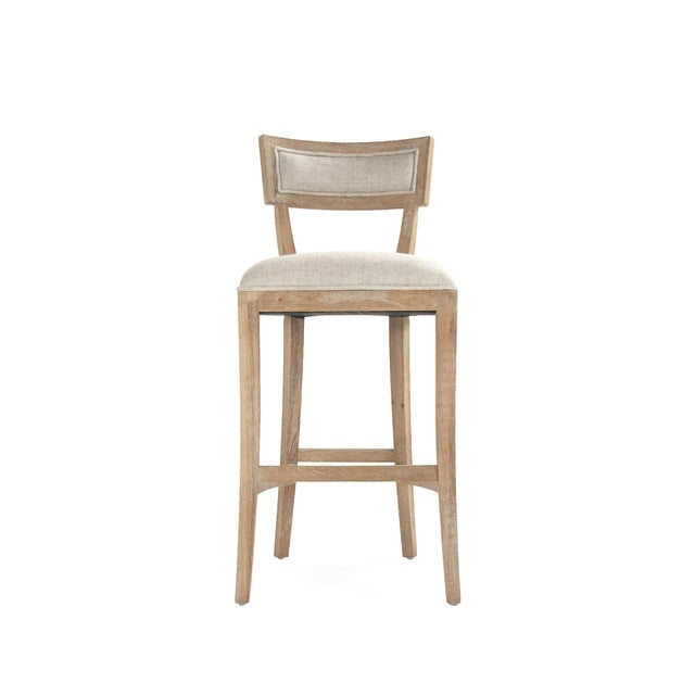 Curved back bar stool upholstered in natural cream linen on limed grey oak legs.