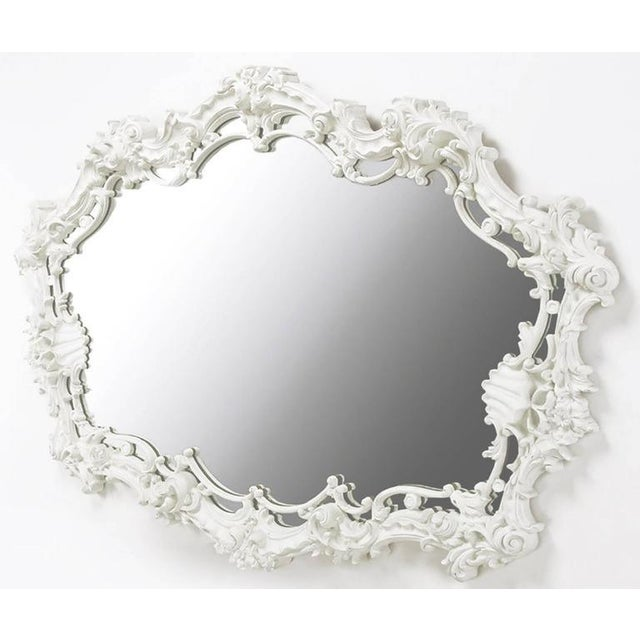 Extraordinary cast gesso Italian Rococo mirror in white lacquer with filigree and shell detail. Perfect for a vanity, over...