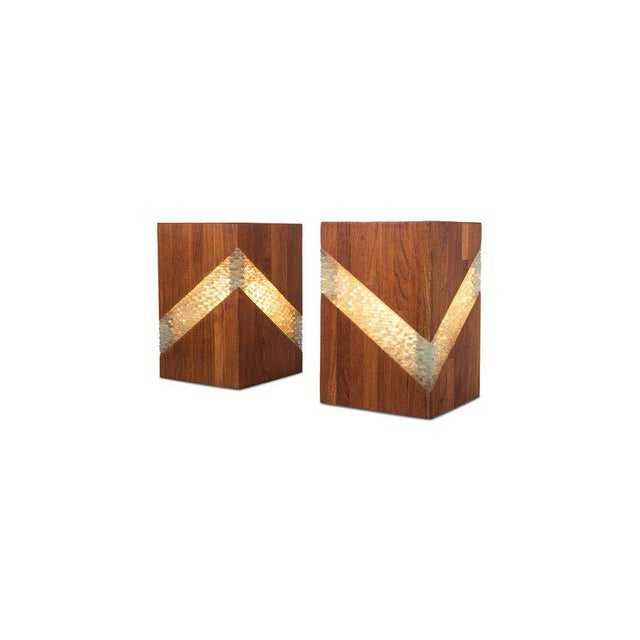 Teak and glass table lamps. The glass is structured and goes very well with the warm colored teak body showing a beautiful...