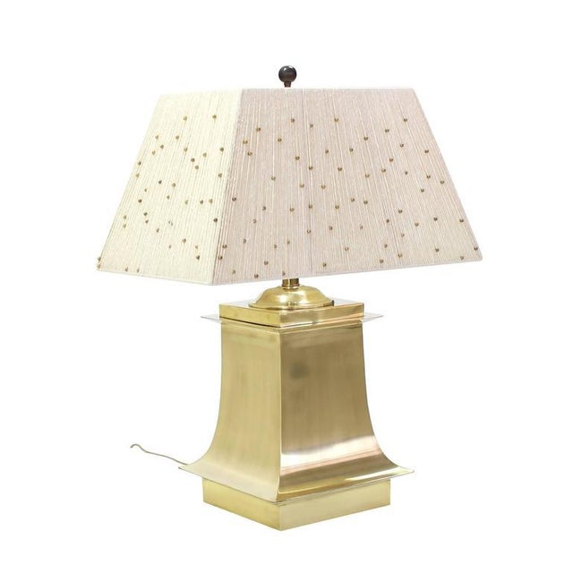 Interactive sculpture like shades table lamps. The shades are decorated with hundreds of brass beads that slide up and...