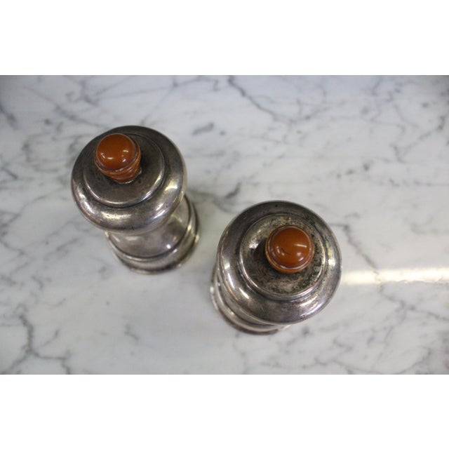 Curious art deco style Exeter salt and pepper shakers in silver plate.