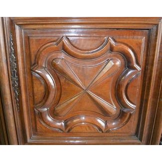 This is an Early 18th Century finely carved French Walnut Armoire