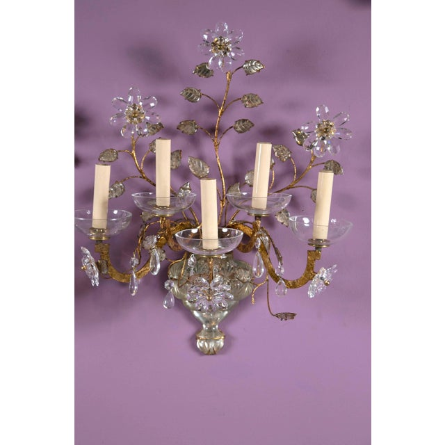 A stunning pair of French gilt and crystal sconces. Charming crystal flowers with amethyst crystal leaves, circa 1930s....