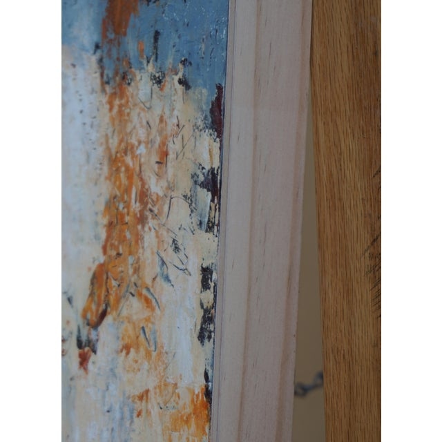 Doubling Back is done in a mixture of oil paint and cold wax. The artist scraped through the layers to achieve the...