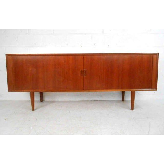 This magnificent server features an incredible teak finish, plenty of shelf and drawer space for storage, and beautiful...