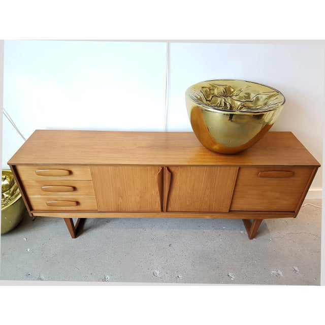 Mid Century Modern Danish sideboard or credenza, in cherry wood, clear beige color. Denmark buffet, 1960s. The Danish...