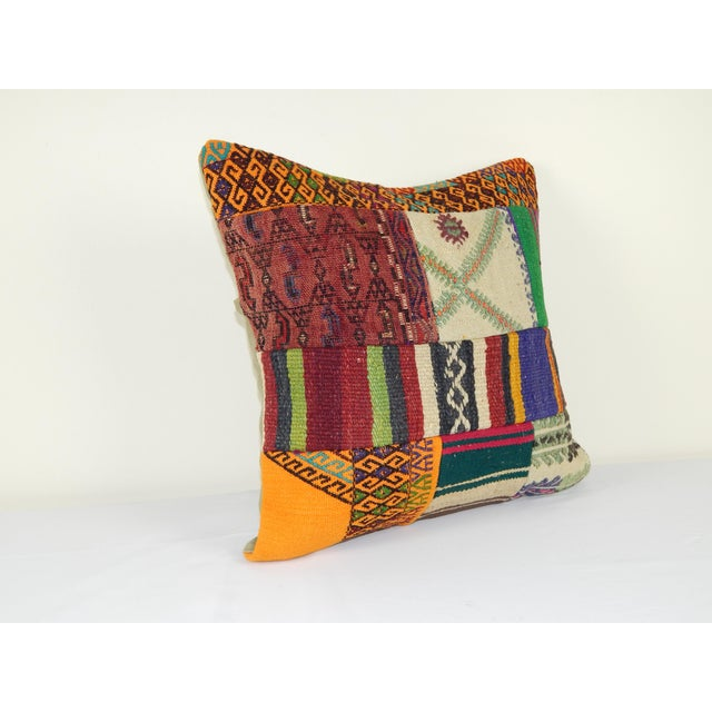 "These beautiful 20"" x 20"" pillow covers were made from an authentic, vintage Turkish rug handwoven in the 1960s. Bright..."
