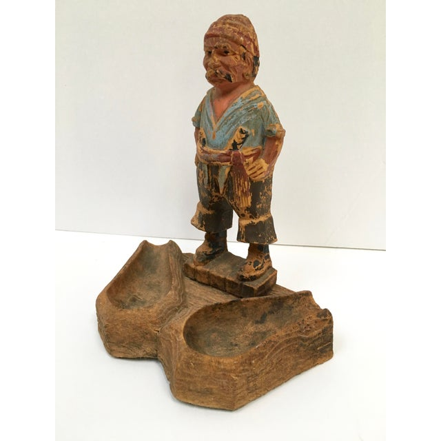 Pure pirate charm. Hand carved wood pipe holder imported from Germany. The pirate character has amazing carved and hand...