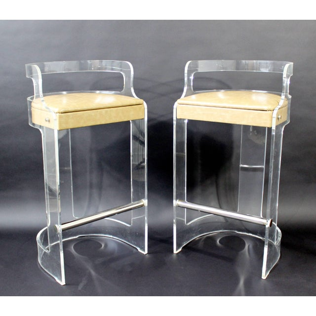 For your consideration is a fabulous set of four Lucite bar stools, with chrome bars and beige leather seats, by Hill...
