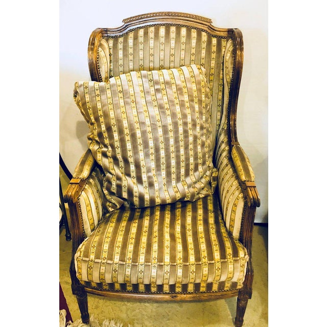 A Jansen style Louis XVI fashioned living room suite having a settee and two lounge chairs. This finely carved and...