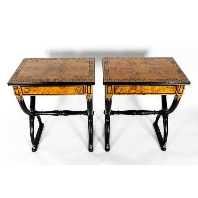 Pair of partially ebonized side or end tables with greek key top design details. Each table is in excellent antique...