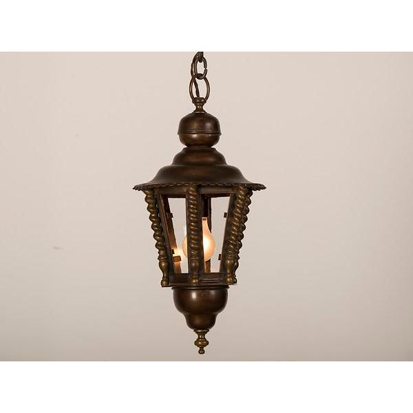 A handsome brass hall lantern from France c. 1920 with a hexagon shape. The six panes of clear antique glass allows a...