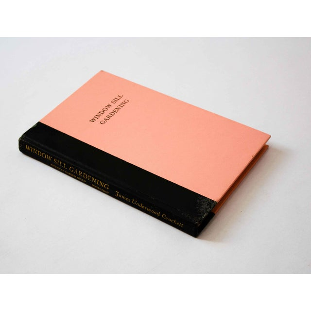 A beautiful book with a minimal black and pink cover. Several pages of full-color vintage illustrations.