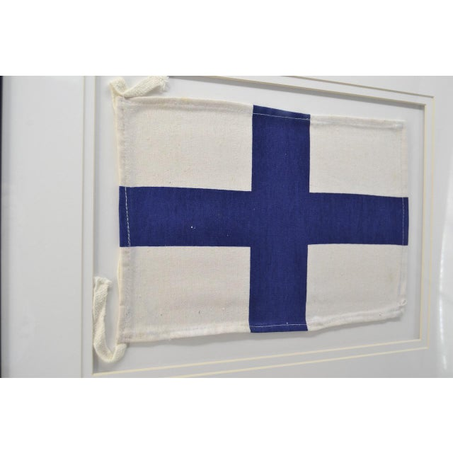 Authentic signal flags made from cotton. Framed in a wood frame. Double mats. Great for any room! See all of the ones we...