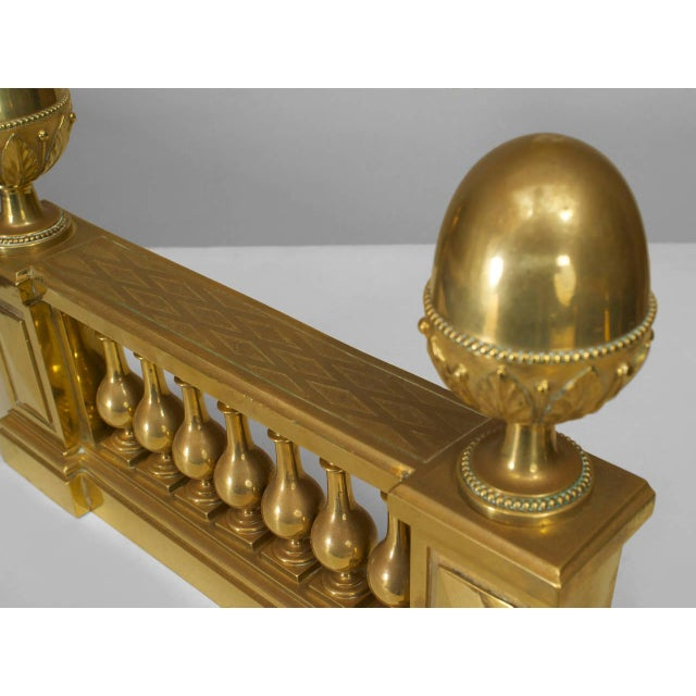 Pair of turn of the century English Adam style brass balustrade design andirons with large acorn finial sides.