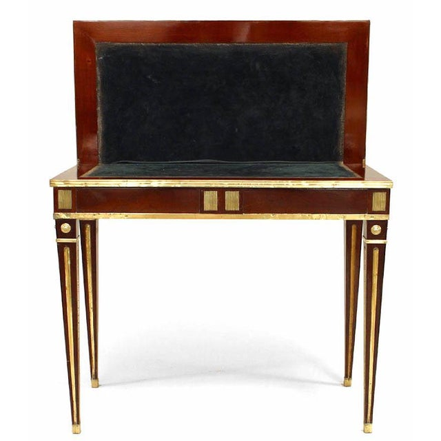 Russian neoclassic brass-mounted mahogany game table (console) with pivoting top opening to a square green suede inset...