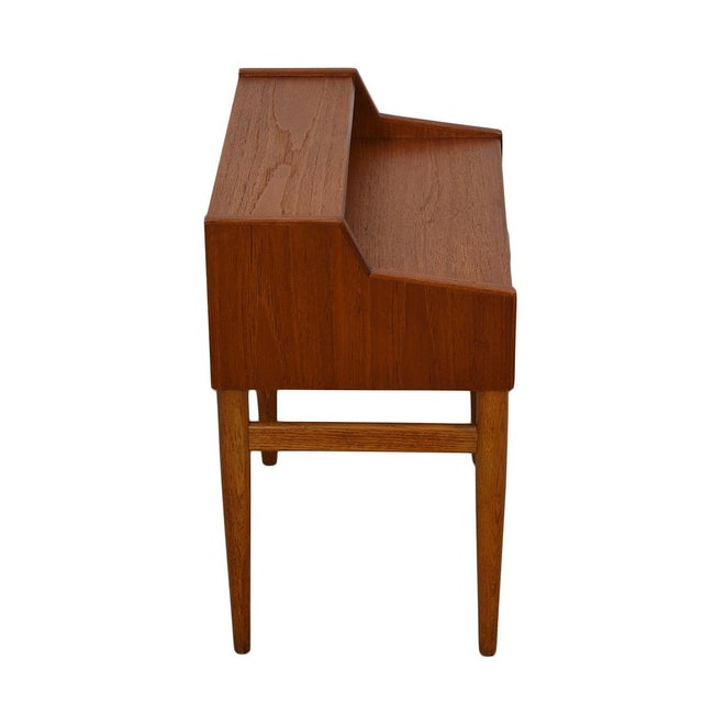 This pair of petite Danish Modern nightstands features a split level top providing two levels of surface area, cubby...