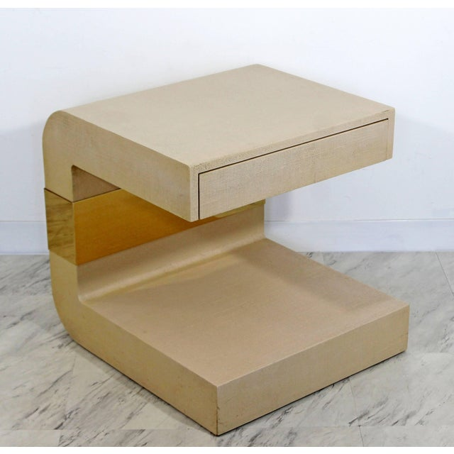 For your consideration is a stunning, sculptural side or end table, with one drawer, made of grasscloth and brass,...