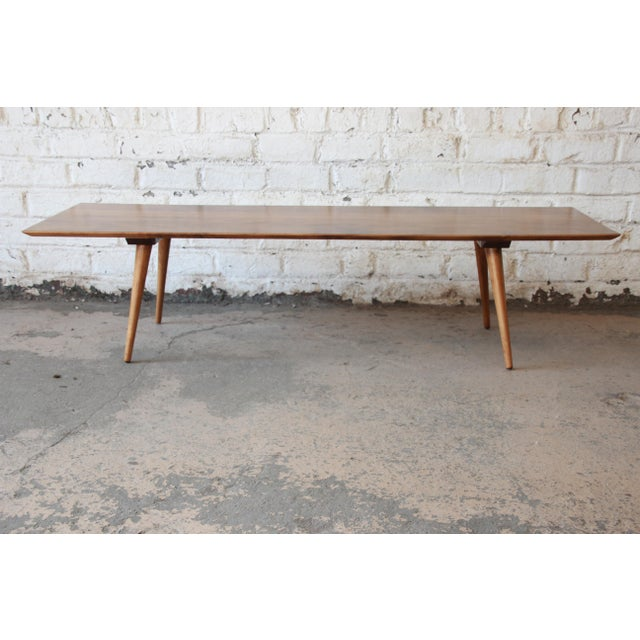 Offering a very nice newly refinish Paul McCobb Planner Group coffee table by Winchendon Furniture. The table has clean...