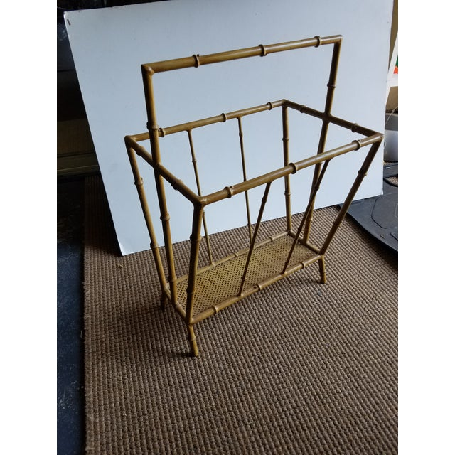 "From the 50's a metal Faux Bamboo Magazine Stand. Excellent condition. 20""h to the top of the handle. Painted the color of..."