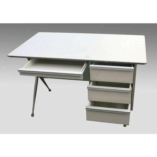 4 drawer institutional desk. We have 5 of these desks. Two of the desks have orange backings. The other four have green...