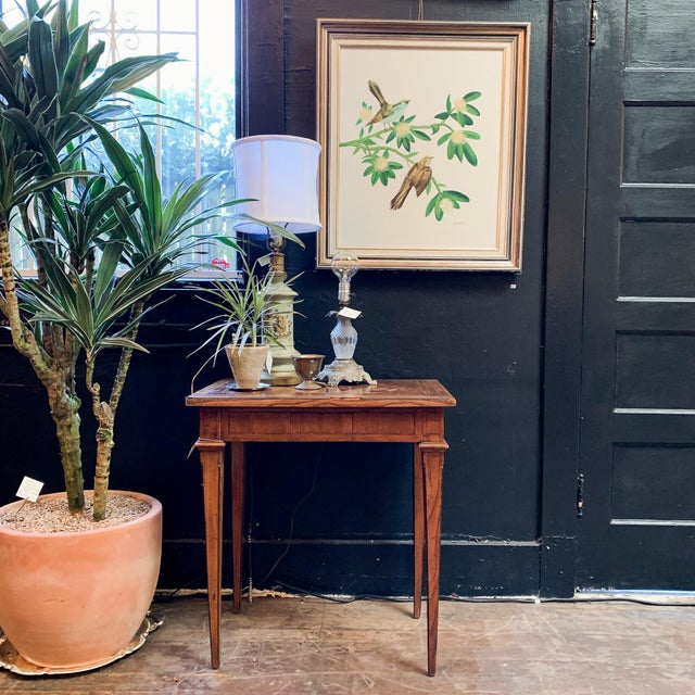 Stunning antique Napoleon style side table with secret drawer. Made in the late 1800's. Some chipping along the top edge,...