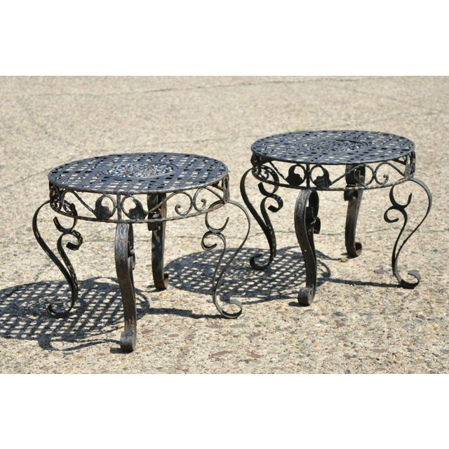 French Art Nouveau Style Wrought Iron Lattice Top Round Side Tables - a Pair. Item features woven lattice top, wrought...