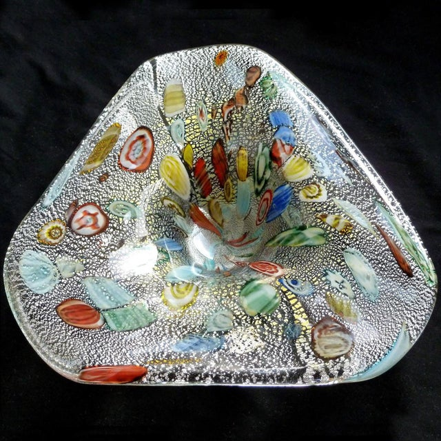 Beautiful vintage Murano hand blown silver flecks, millefiori and cut canes Italian art glass bowl. Created in the manner...