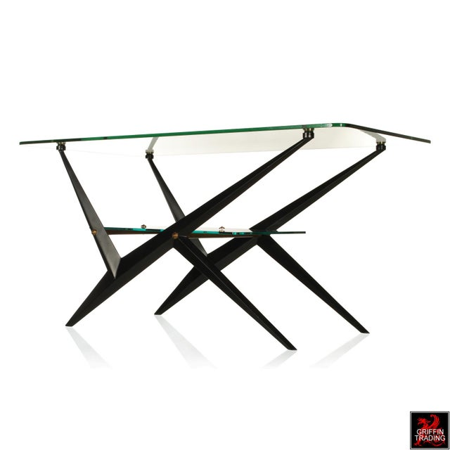 This stylish and sophisticated two-tier table is by the Italian Designer Angelo Ostuni. The striking features of this...