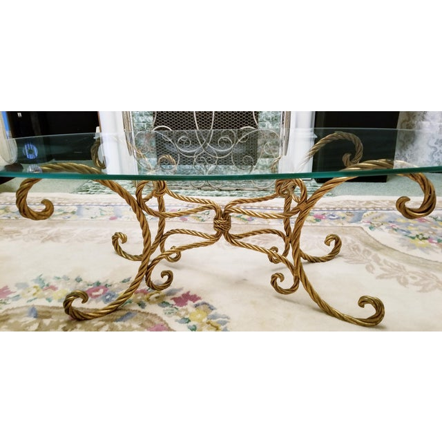 Fabulous vintage Italian gold rope and tassel coffee table with oval glass top. Still has original metal tag that reads...