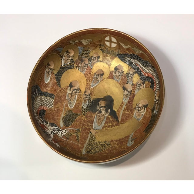 Antique two-sided hand-painted large golden satsuma bowl signed. presenting large patten with dragon and group of scholars...