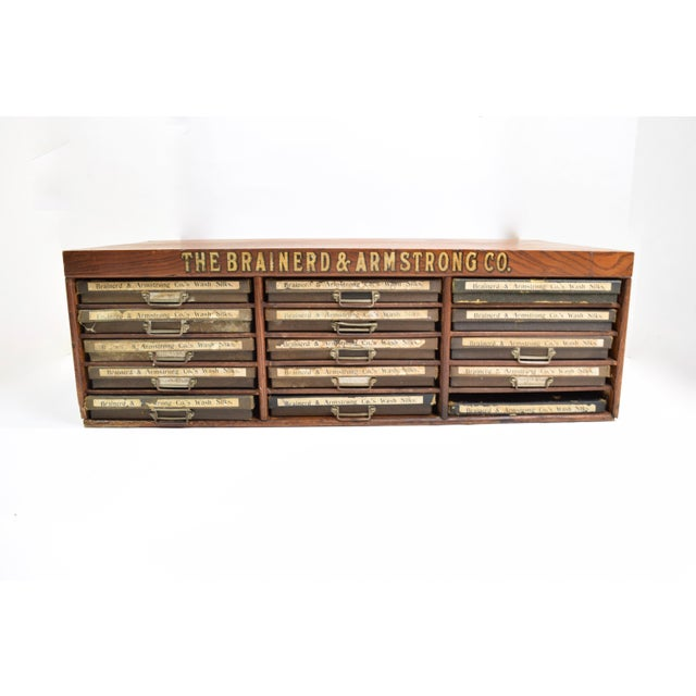Circa 1910 the Brainerd&Armstrong Co Multi Drawer Cabinet. Used to display silk thread. Made of Oakwoods and 15 cardboard...