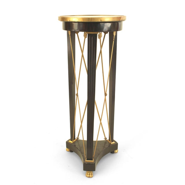"""French 1940s (Louis XVI style) ebonized pedestal with bronze """"X"""" design between three tapered legs ending in a platform..."""