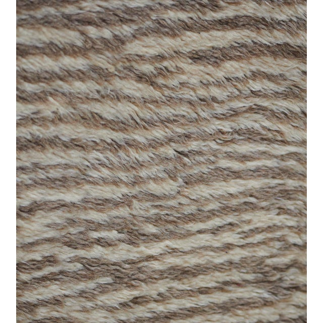 Part of the Mansour Modern collection, this deep pile, vintage-inspired rug is handwoven by master weavers using the...
