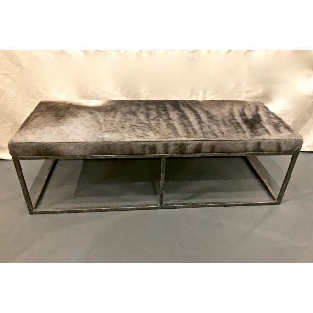 This is an elegant wrought iron and hide long bench that most probably dates to the late 20th century. The solid iron...