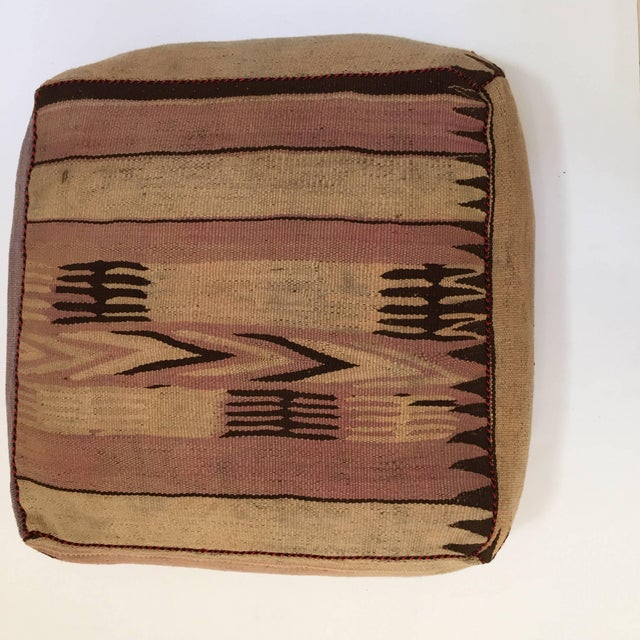Moroccan vintage floor pillow seat cushion made from a Tribal Kilim flat-weave Berber rug. Square shape with nice faded...
