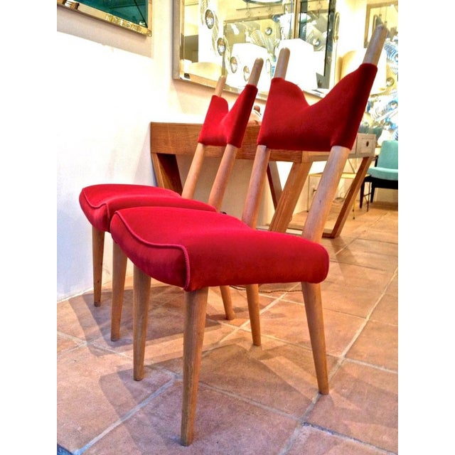 "Jean Royere Pair of Documented Chairs model ""Baltique"" Covered in Red Velvet."