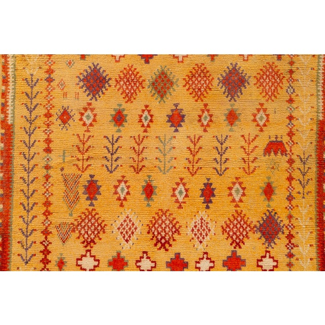 Antique hand-knotted Moroccan rug with an all over motif. This piece has fine details, great colors, and a beautiful...
