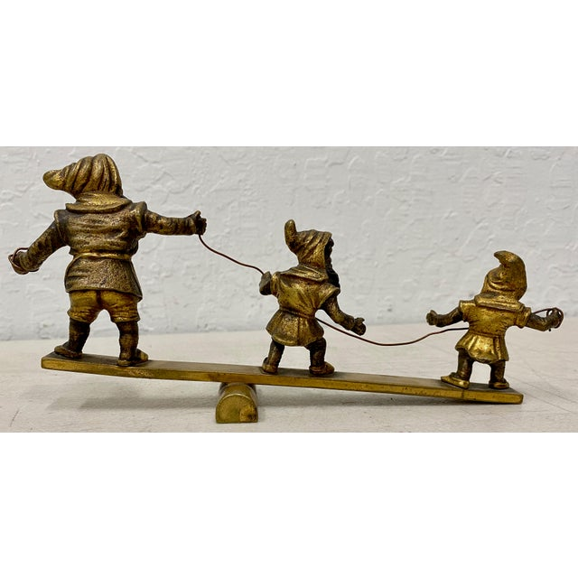 Early 20th C. Gilded Bronze Sculpture of Three Balancing Dwarf's Three bearded Dwarf's balancing on a seesaw. Dimensions...